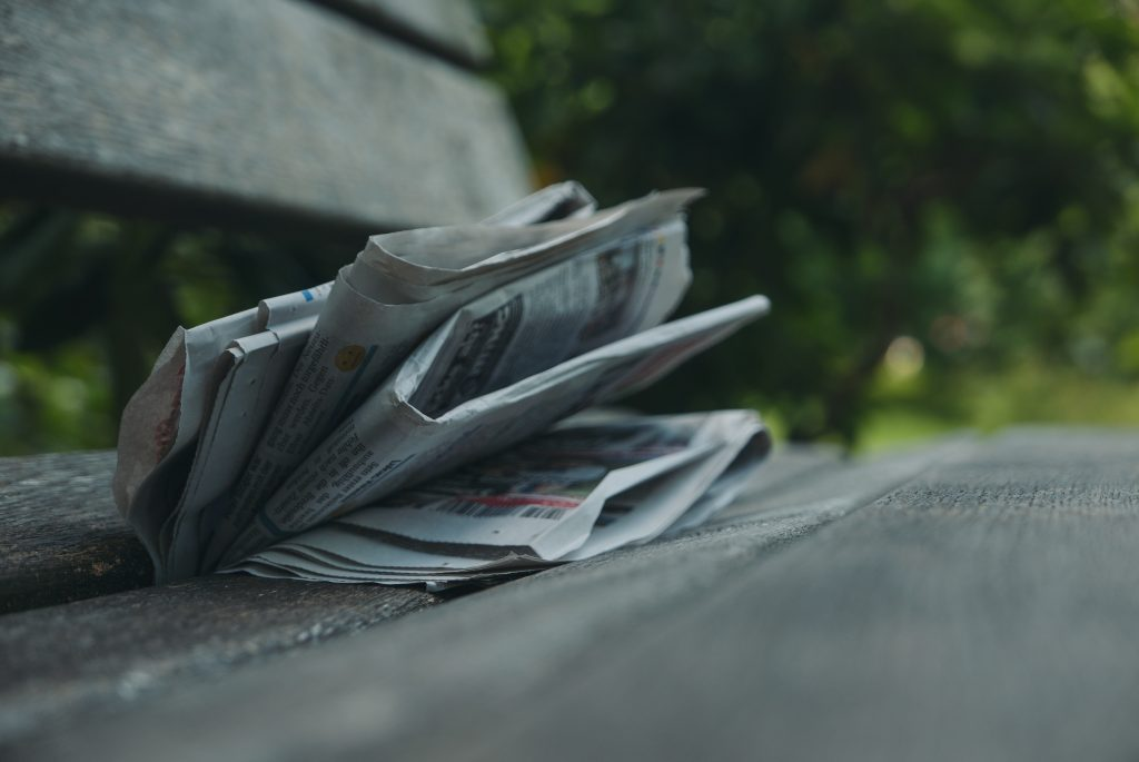 """A newspaper crumpled into a park bench from the Heed PR post """"How To Make Sure You Don't Do Worthless PR"""""""